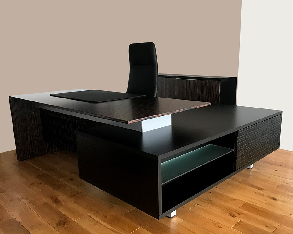 Modi L - shaped Executive desks with real wood desk tops , white glass or black glass desk tops also available. Shown with a high back black leather executive chair in real Italian leather. The desk has a protective luxury leather desk pad
