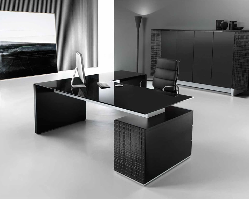 Modi L - shaped black glass Executive desks with black glass desk tops, white glass or real wood desk tops are also available. Shown here with a matching black lacquered tall storage cupboard with hinged doors and glass shelves