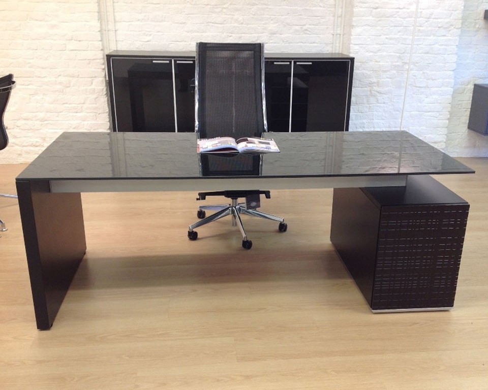 Modi black glass Executive desks with a black glass desk top and matt black lacquered structure. shown here with matching black glass sideboards and a high back mesh chair