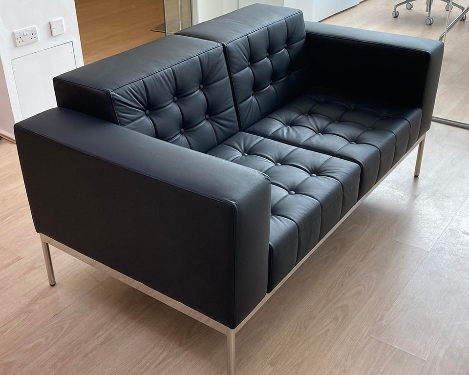 class made - executive style designer two seat office sofa with buttons in black leather
