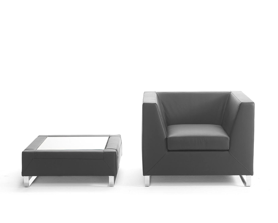 Go Beyond armchair and coffee table for offices and reception areas in black leather