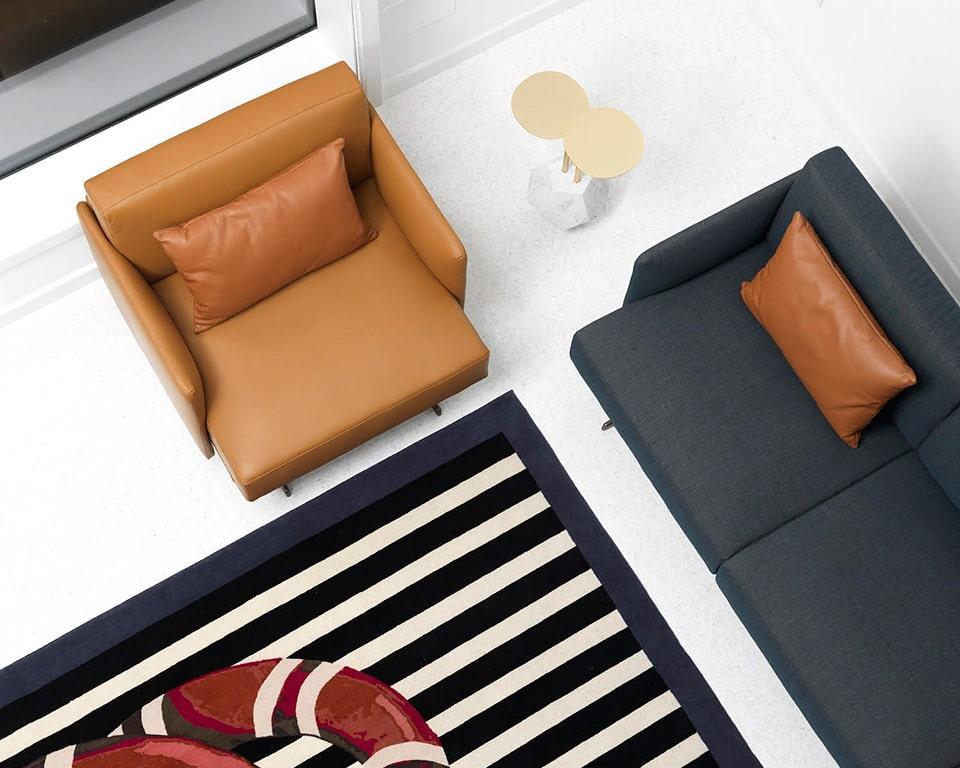 designer arm chair and Italian sofa range in blue fabric