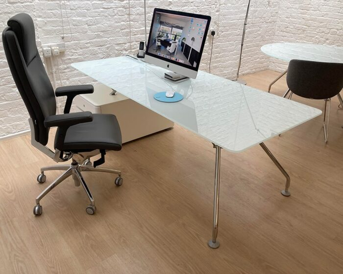 Prospero designer desks with white glass desk tops and lacquered structural storage