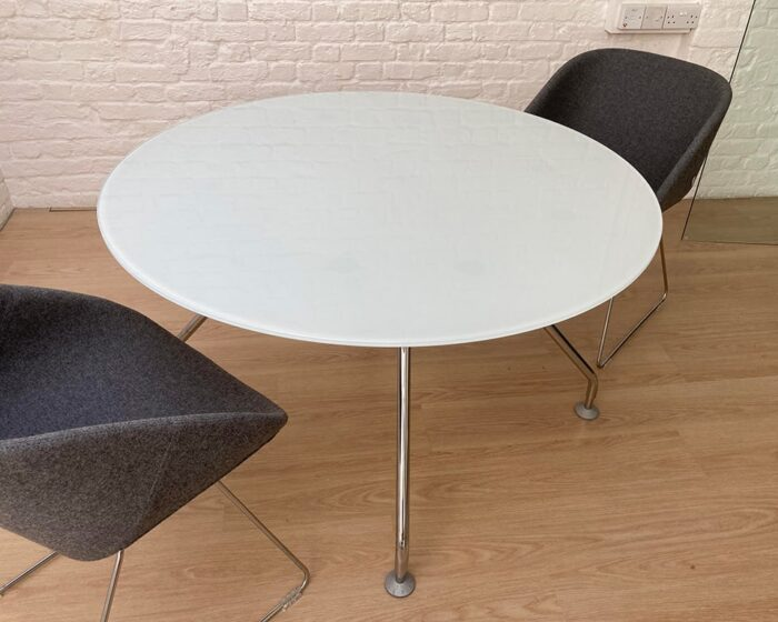 Prospero round meeting tables to match Prospero designer desks with white glass desk tops and lacquered structural storage