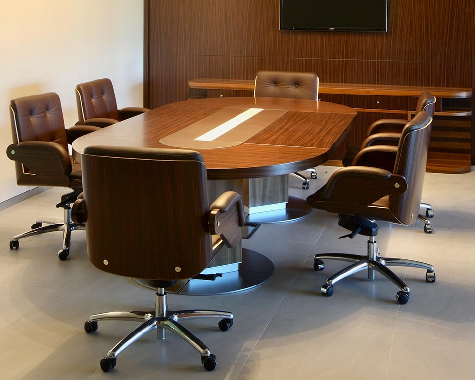 Taiko Luxury Executive Boardroom tables with wire management/ Leather inlaid central section and matching high quality Nesi leather boardroom chairs from italy