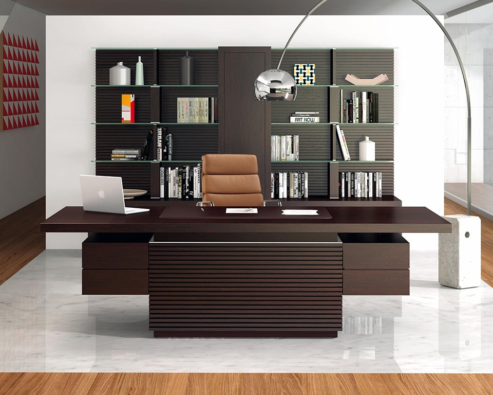 Taiko Luxury Dark wood CEO executive desk with leather inlaid top and modesty panel. shown here with matching tall bookcase and luxury leather executive chair
