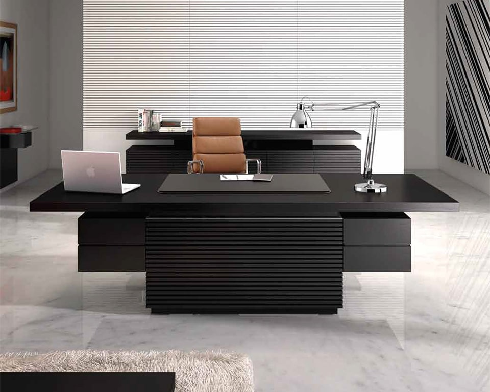 Taiko is a Luxury high - end black ash wood CEO executive desk with a black leather inlaid desk top and wire management. Shown here with a matching black ash sideboard and tan leather executive desk chair