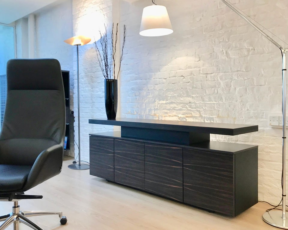 Taiko Luxury Executive sideboard with glass shelves and matching wood finish to Taiko executive desks. Shown here in exclusive Ebony wood to match our Ebony wood Tau executive CEO desks
