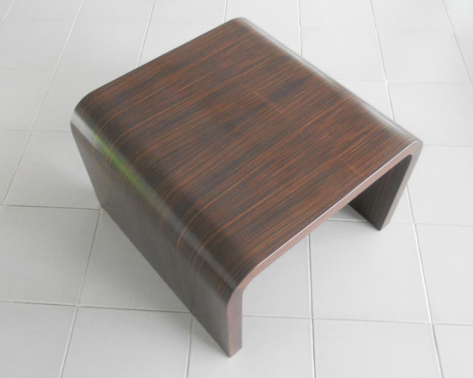 Tau Luxury Executive coffee tables shown here in ebony wood to match the luxury Tau executive office furniture range