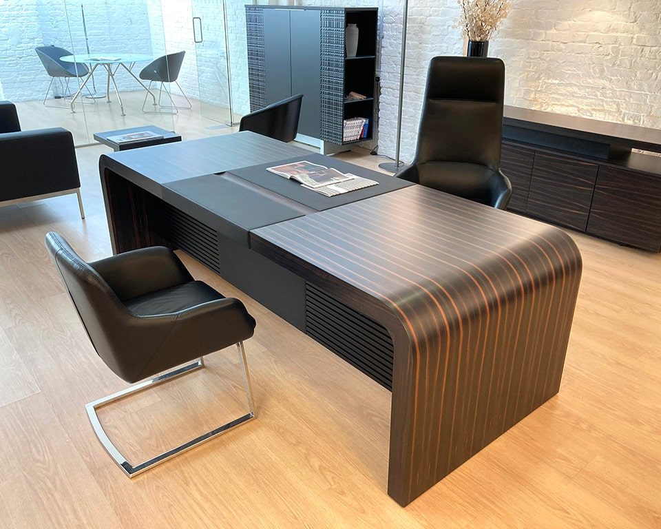 Tau high quality executive office desks and large directors desks. Shown here in real ebony wood with personal drawers and leather inlaid top and modesty panel. A large luxury executive desk at 2600 or 2850 wide.
