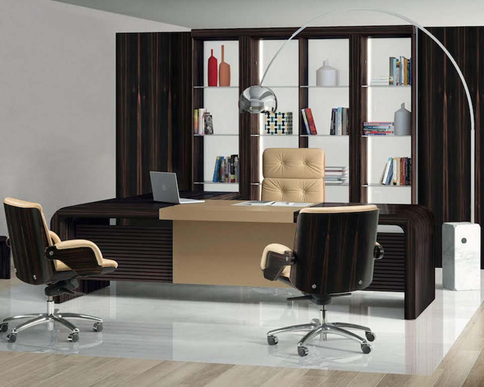Tau CEO executive desks and directors desk shown here in real high quality ebony wood with drawers and a leather inlaid desk top and modesty panel . Shown here with a matching glass and ebony bookcase with matching Nesi leather and ebony executive chairs