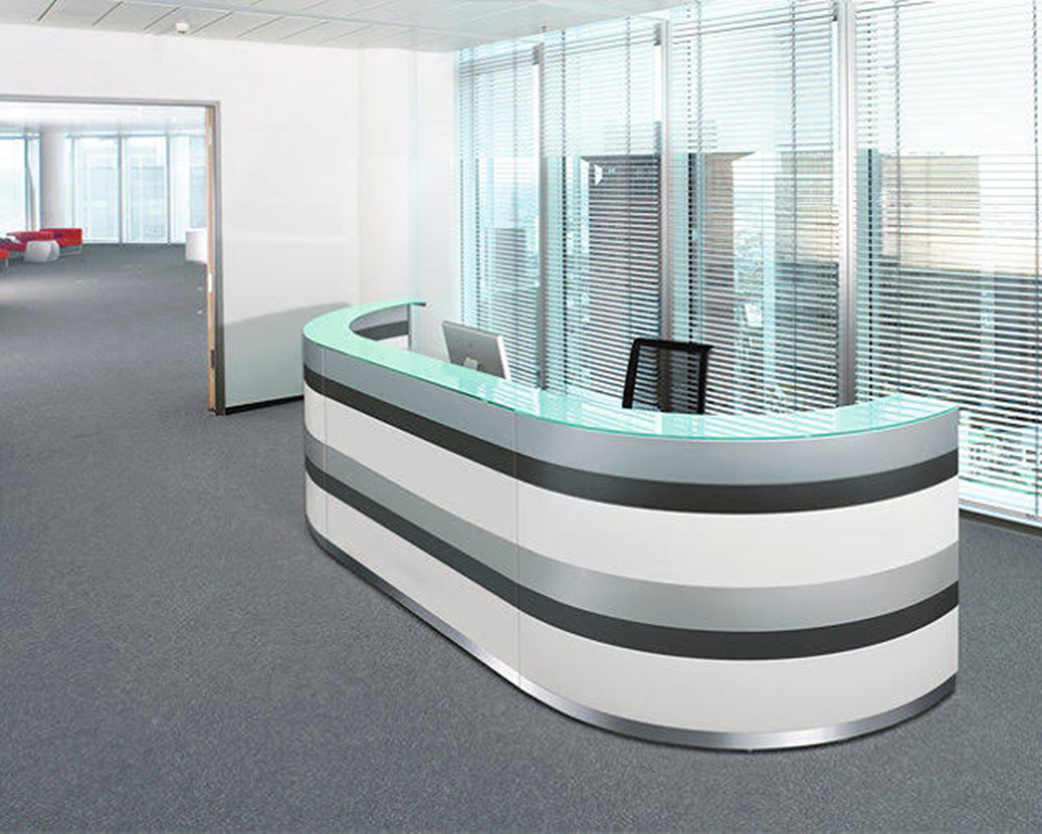 Twist brightly coloured reception desk with low DDA module and matching storage