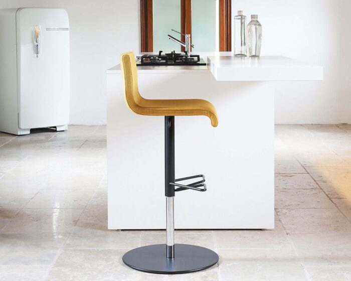 Amba Adjustable luxury bar stool with a comfortable back shown here in yellow with a black frame. A stylish modern bar stool for your high end kitchen bar areas