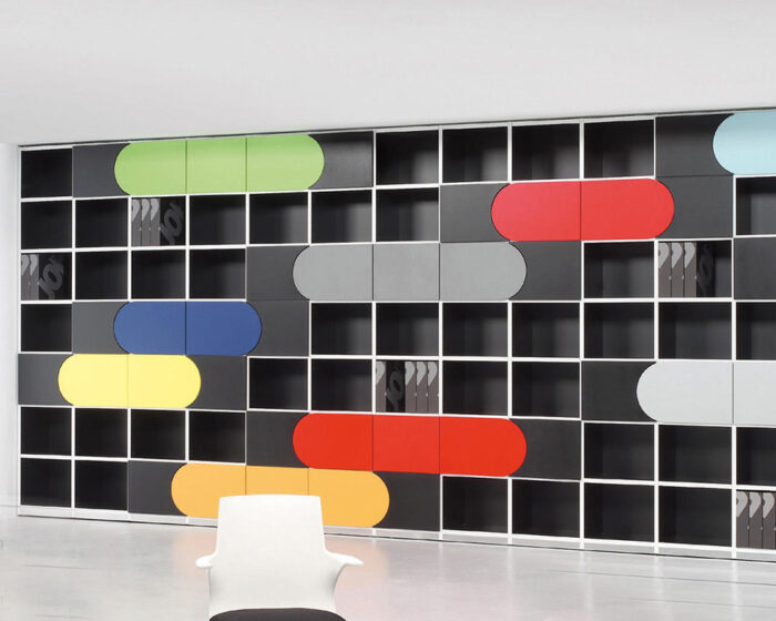 Italian designer open fronted bookcases with concave and convex doors in bright colours