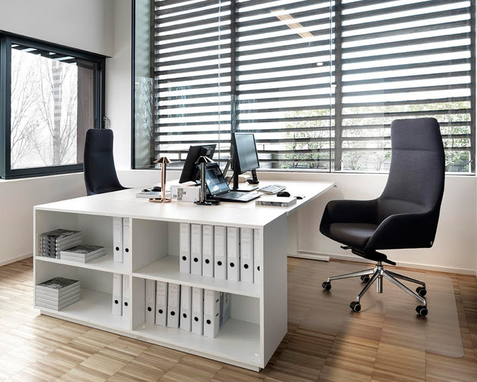 Darwin Luxury Italian Executive chairs in leather of fabric situated behind white desks