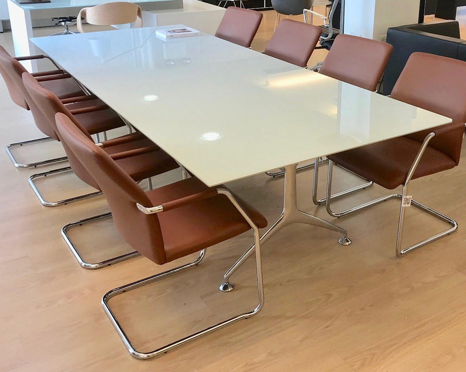 frame-large white glass boardroom table with die cast aluminium legs and tan leather tempo cantilever chairs