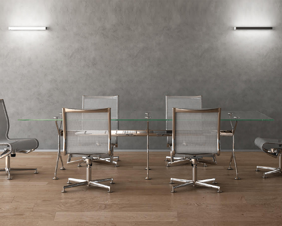 frame-large clear glass boardroom table with die cast aluminium legs with mesh back frame chairs