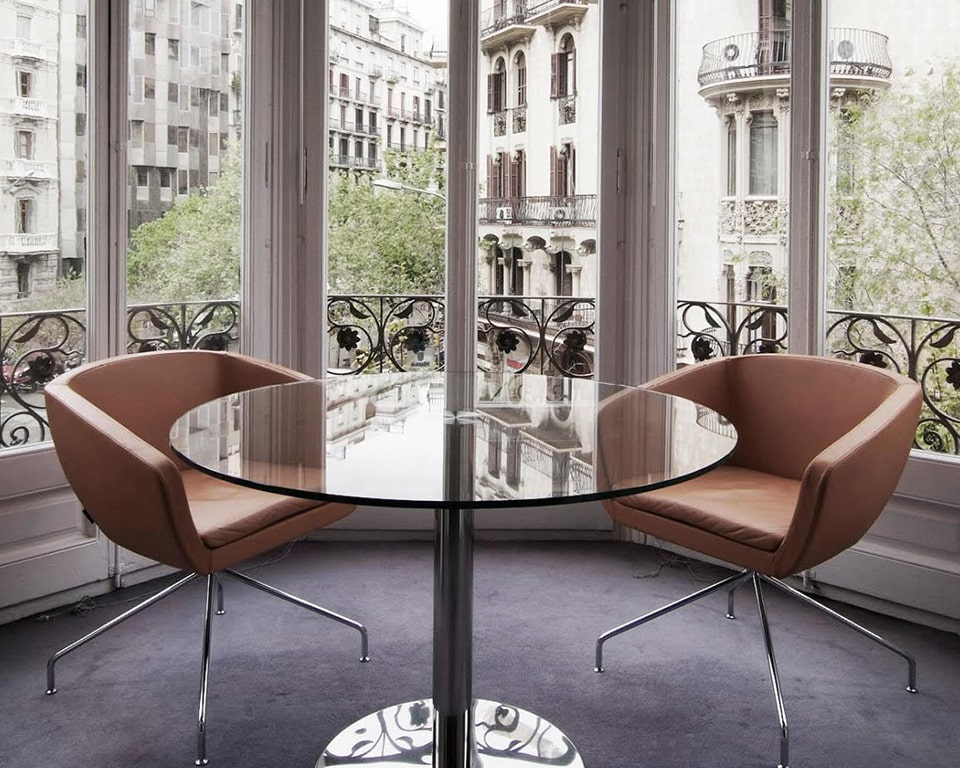 ginkgo-chairs- Italian designer armchairs in tan leather and round glass table