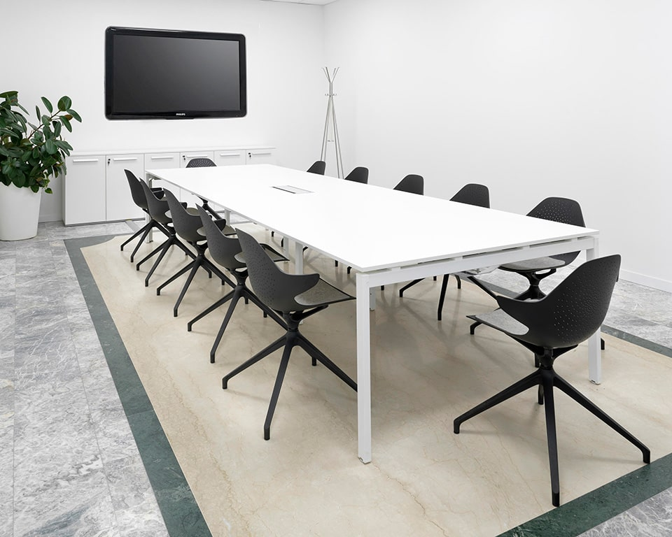 Klera meeting room chairds with arm detail around a white meeting table