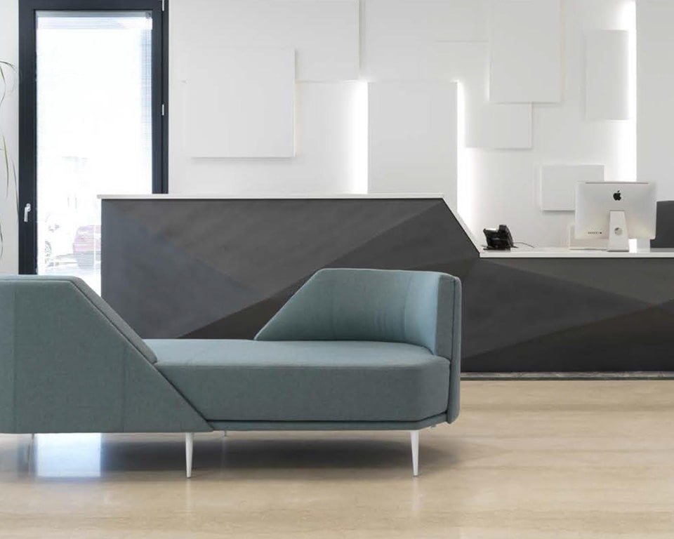 Pergy large Italian two seat lovers style sofa in reception area