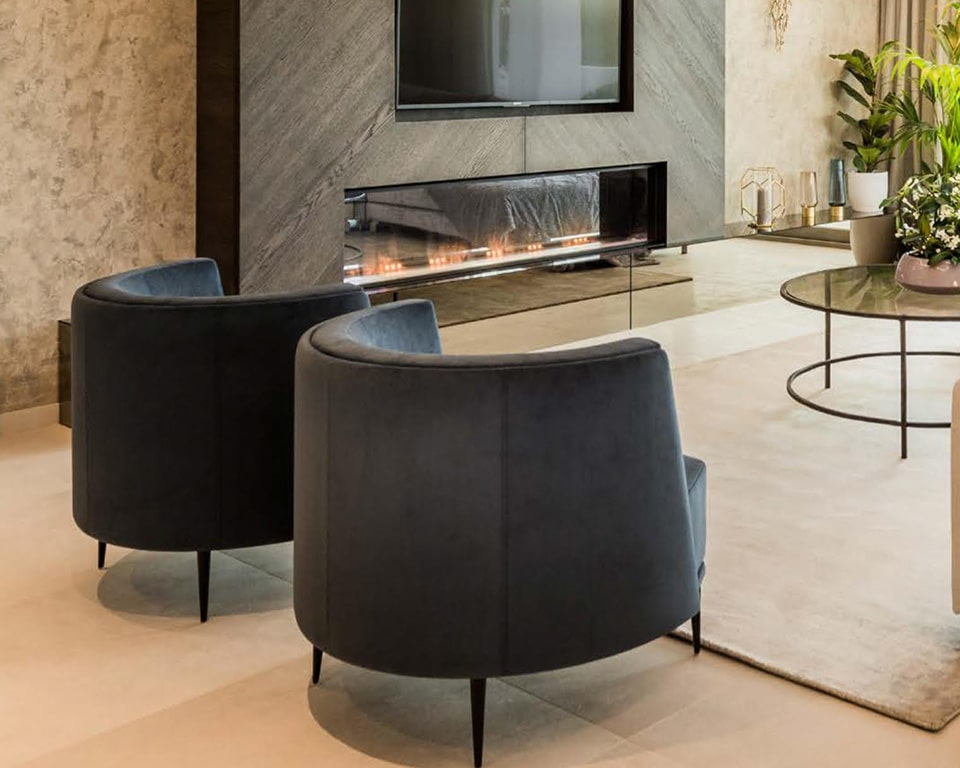 pergy compact armchairs in leather or fabric from Italy in home lounge setting