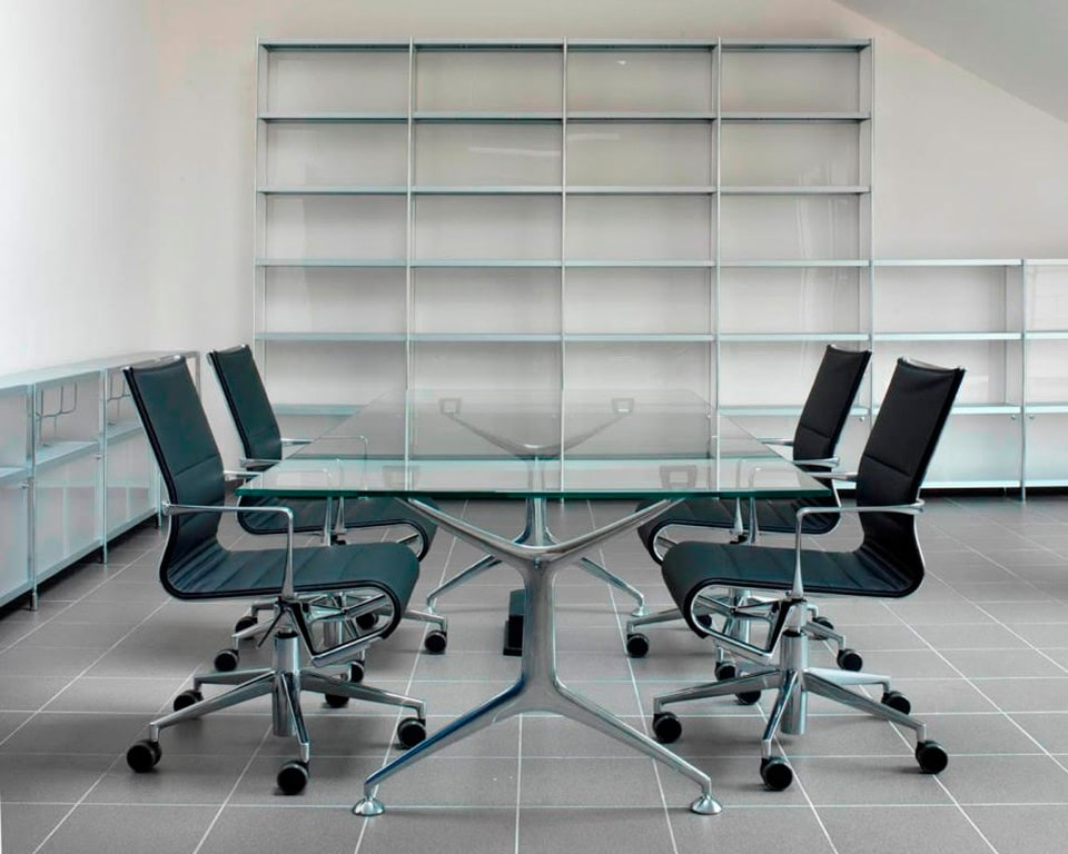 rolling thin padded, executive boardroom chairs around a glass frame boardroom table