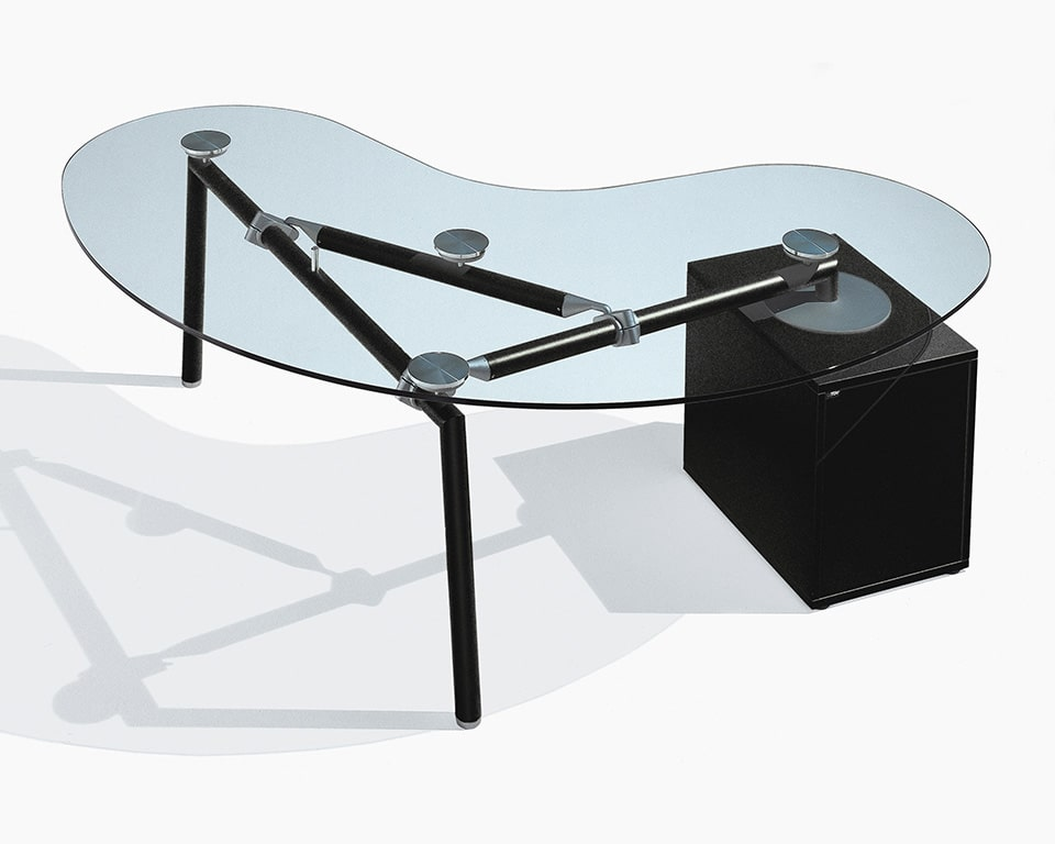 Bean shaped executive desk with an extra clear transparent top and personal storage pedestal