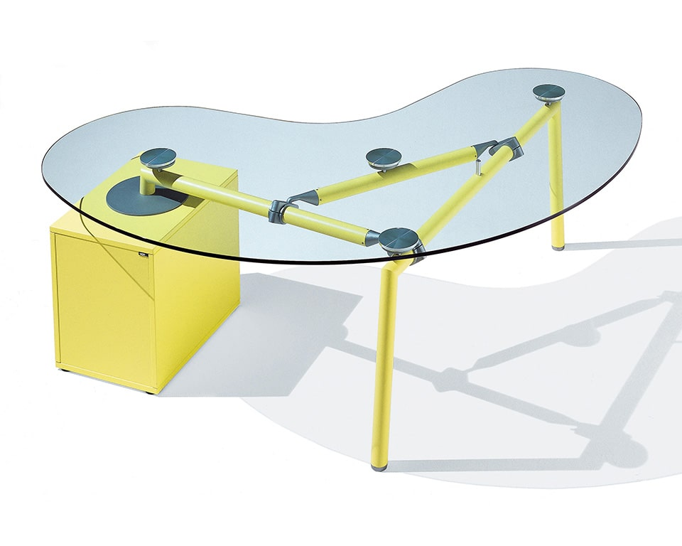 Transparent glass bean shaped desk with yellow frame and structural pedestal