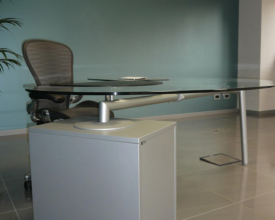 Transparent glass bean shaped desk with aluminium frame and pedestal drawers