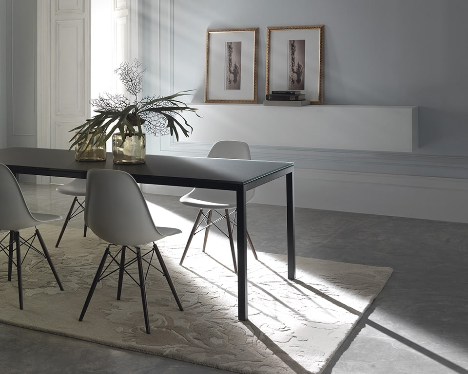 Stylish black glass designer desk that is perfect as your black home office desk. This stylish black glass table iis perfect as a meeting room or dining table