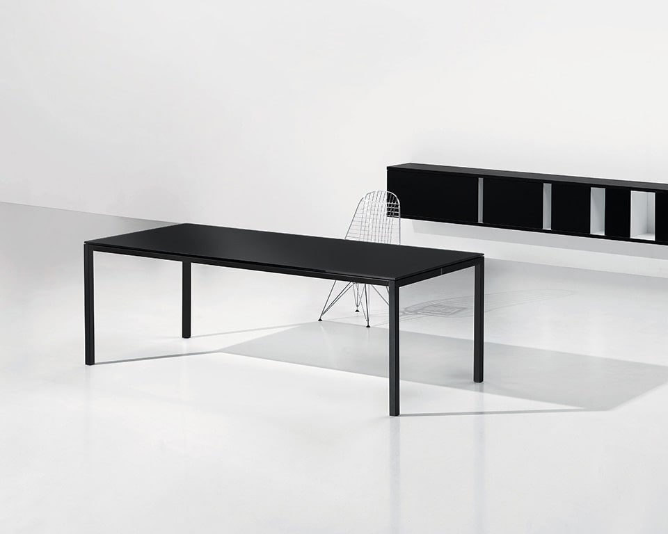 Stylish black glass designer desk that is perfect as your black home office desk with wall mounted storage