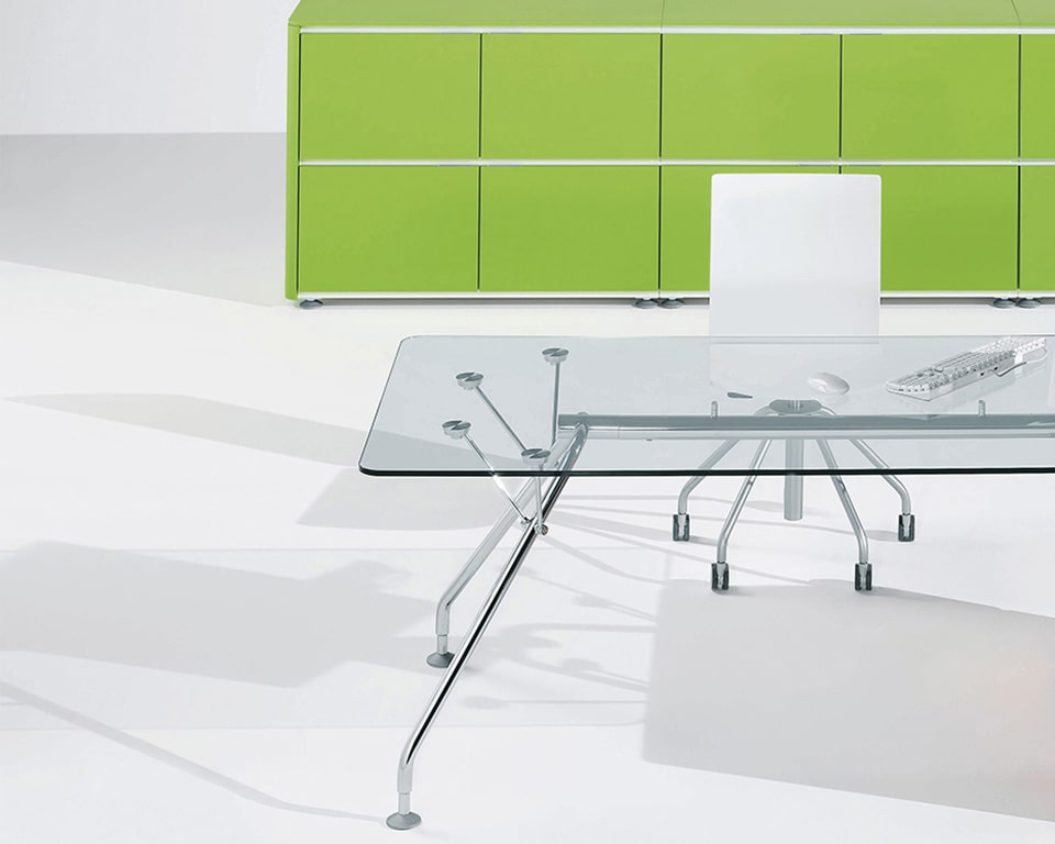 High quality clear glass executive table for meeting rooms or as your home office desk with lime green cupboards