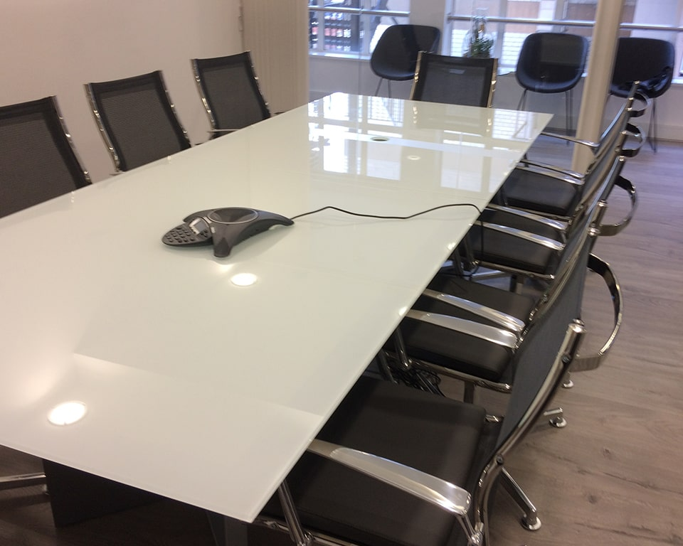 High - end Large Modi white glass boardroom table with Havana mini black leather and black mesh boardroom chairs