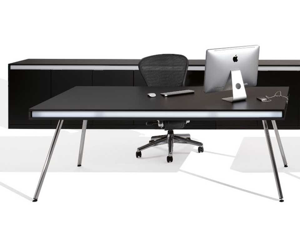 ON DESIGNER DESKS are Luxury High - end designer desk for executives and home offices shown here in black with a matching long sideboard