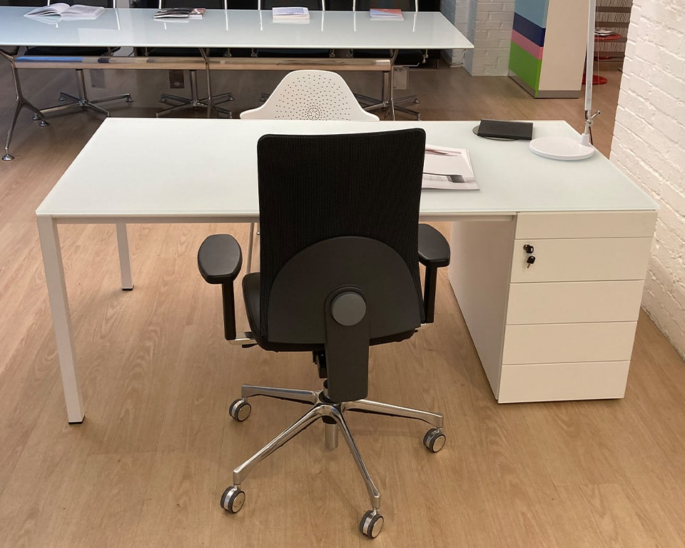 High quality Minimum 1800 x 900 executive desk with a white satin glass desk top and matt white lacquered drawers and legs. the black task chair offsets the desk really well