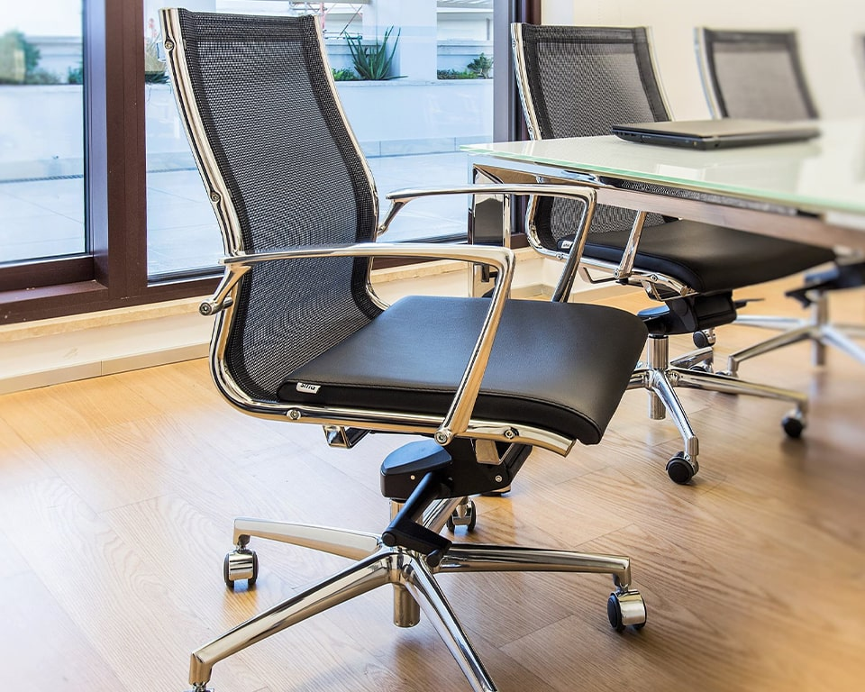 Detail of the superb high end die cast polished aluminium arms and 5 star base on the Havana Mini medium back home office chairs and meeting room chairs. Shown here with a black leather seat and a black mesh back rest