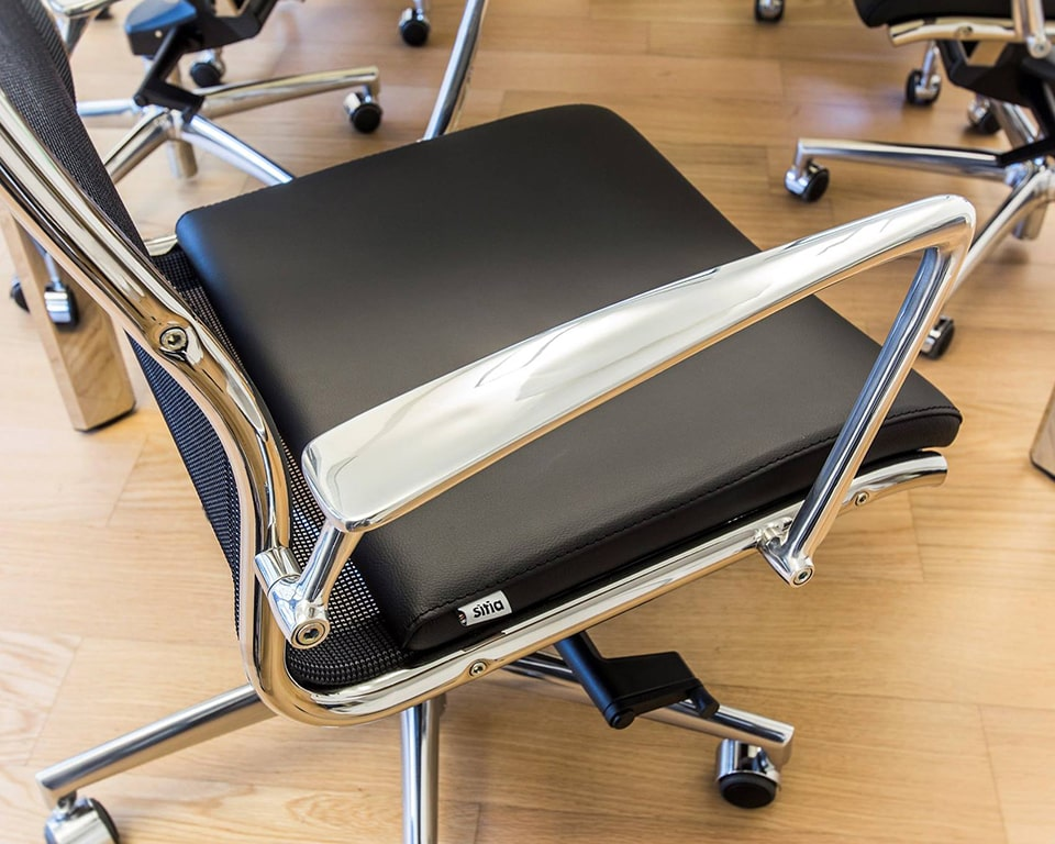 Detail of the superb high end die cast polished aluminium arms on the Havana Mini medium back home office chairs and meeting room chairs. Shown here with a black leather seat and a black mesh back rest