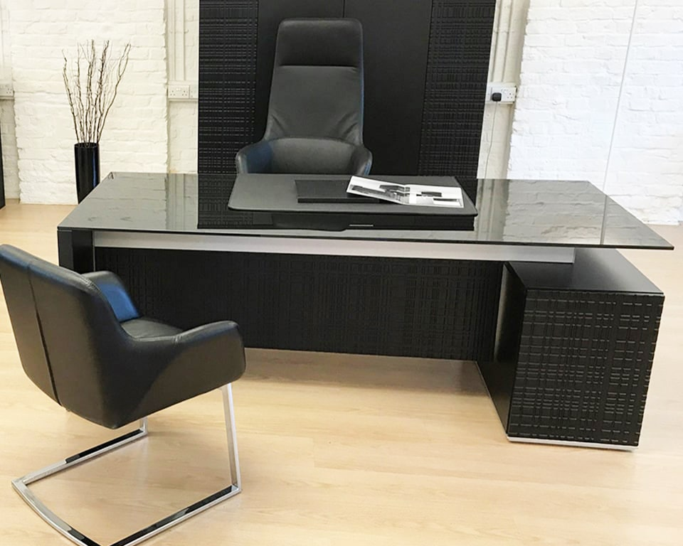 Black glass desks -High quality Modi black glass executive office desk with modesty panel , black leather Darwin executive chairs and a matching bookcase