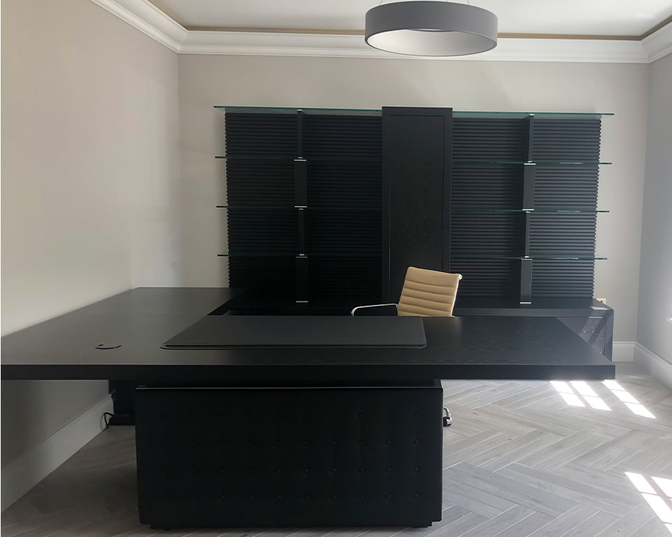 Large Taiko L shaped executive desk in black ash wood with a matching black ash wood and glass bookcase