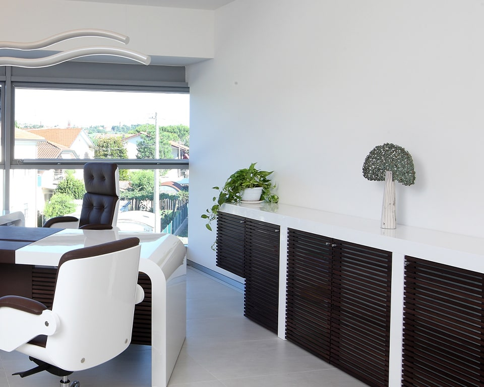 The luxury Tau sideboard is shown here in high white gloss with the stylish dark wood strips design on the glass doors. Pictured with the Tau white gloss executive desk and-matching white gloss Nesi executive leather chairs