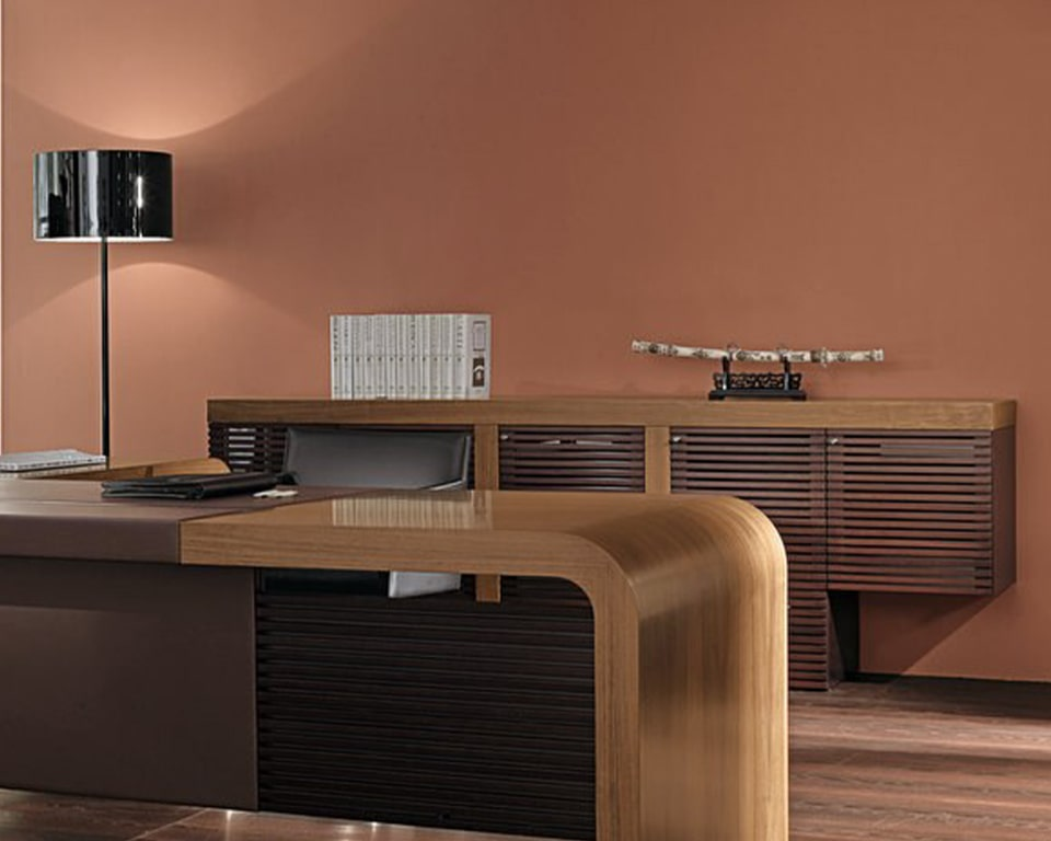 Tau high end executive desk range with 80 mm thick desk tops. Shown here with the low credenza with wood strips design on glass doors. Tau executive desk and sideboard are both in Italian Walnut wood.