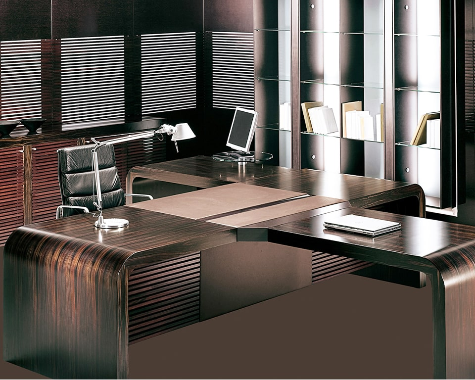 CEO Executive desk-The Tau extra large 2850 mm wide luxury executive desk with side return can also as shown here have a meeting extension suitable for 4 visitors chairs. This exclusive executive desk is shown in real ebony wood with a matching sideboard and bookcase