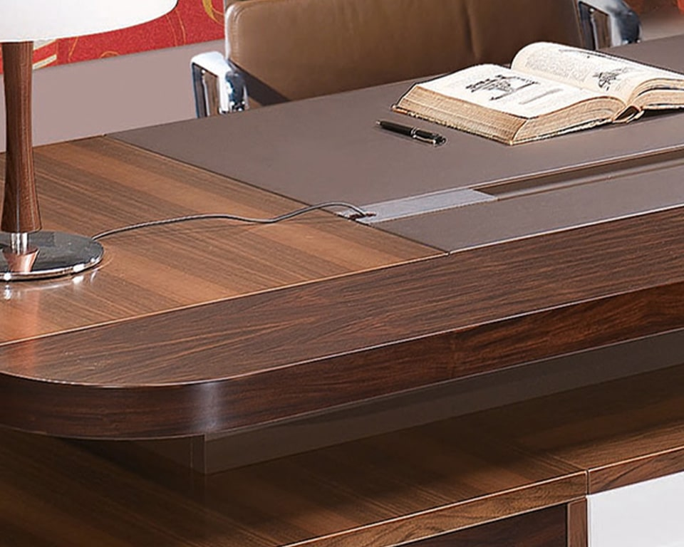 Luxury executive desk Detail picture of the rosewood and walnut wood as used on the Edoc double pedestal executive desks . Also shows the wire management cable ports