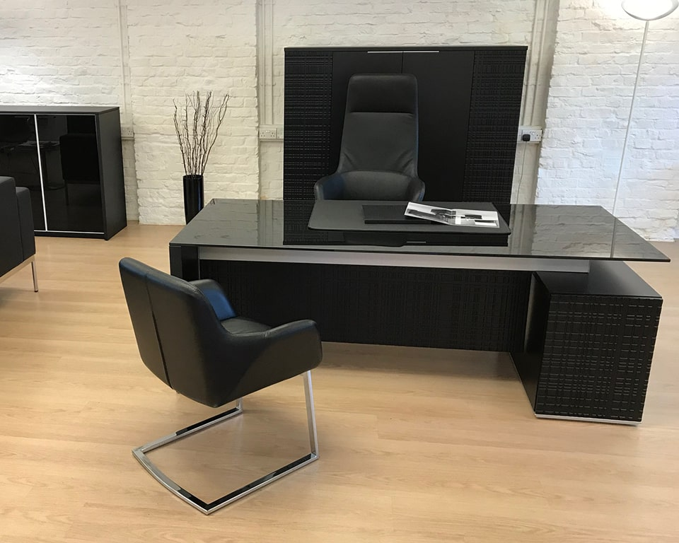 Luxury black glass desk-High quality Modi black glass executive office desk with modesty panel , black leather Darwin executive chairs and a matching bookcase
