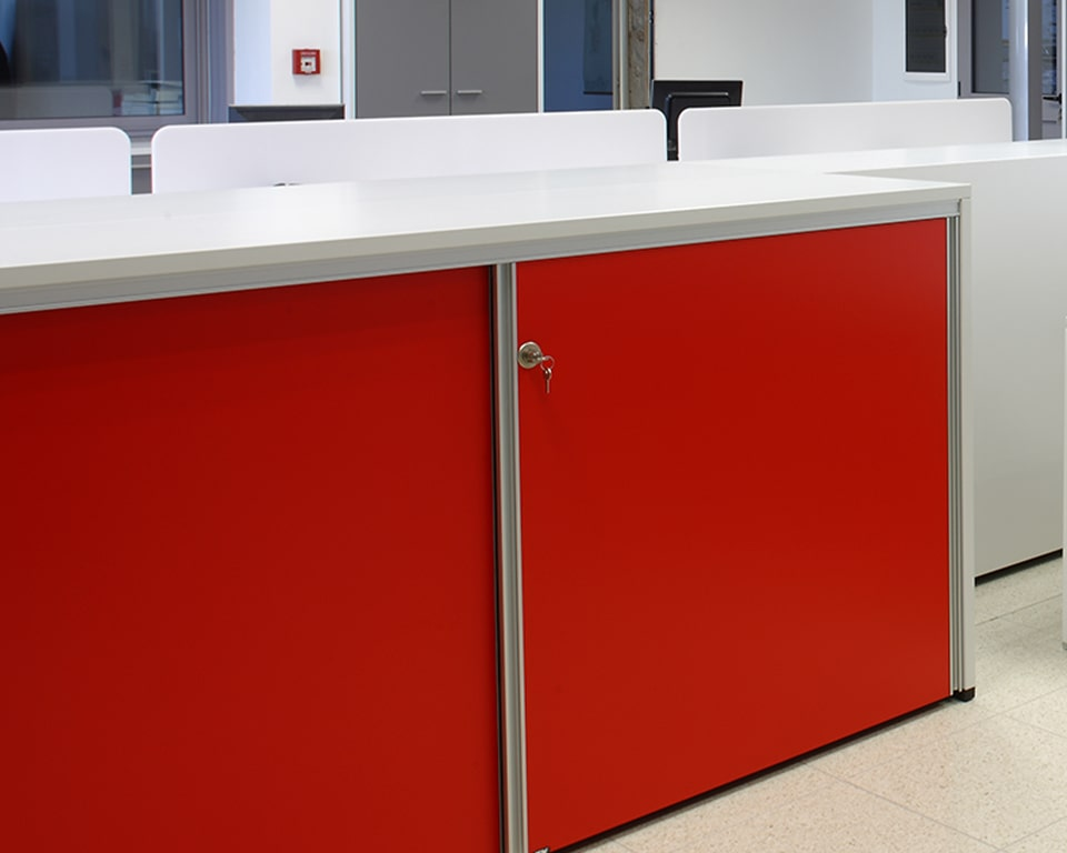 Ekliss Sliding are high quality designer sliding door office cupboards with red doors