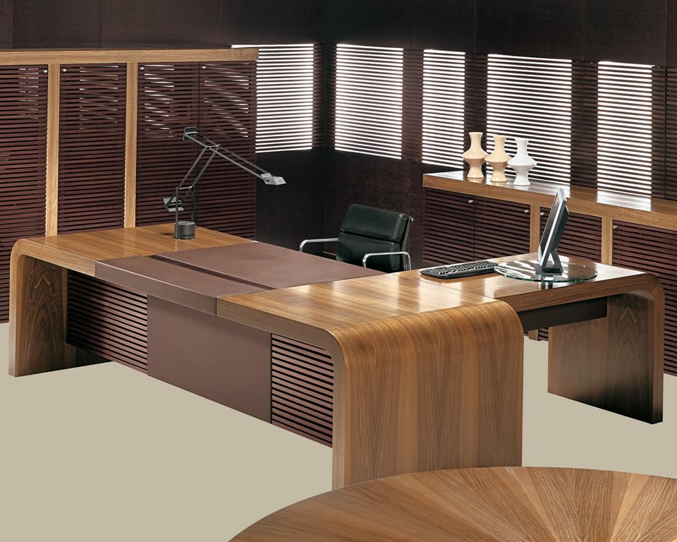 Luxury quality Tau high - end extra large L- shaped CEO style desk in Italian walnut and black leather executive chair, all with matching high cupboards and credenza
