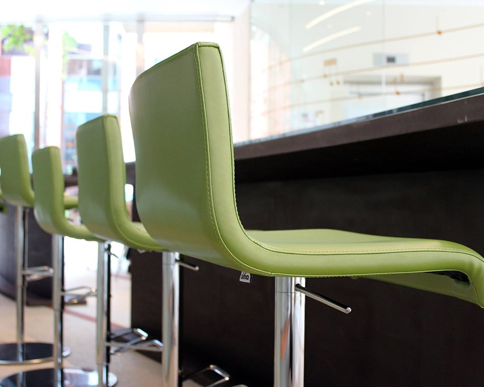Lime green leather luxury bar stools with backs from the Amba barstool range