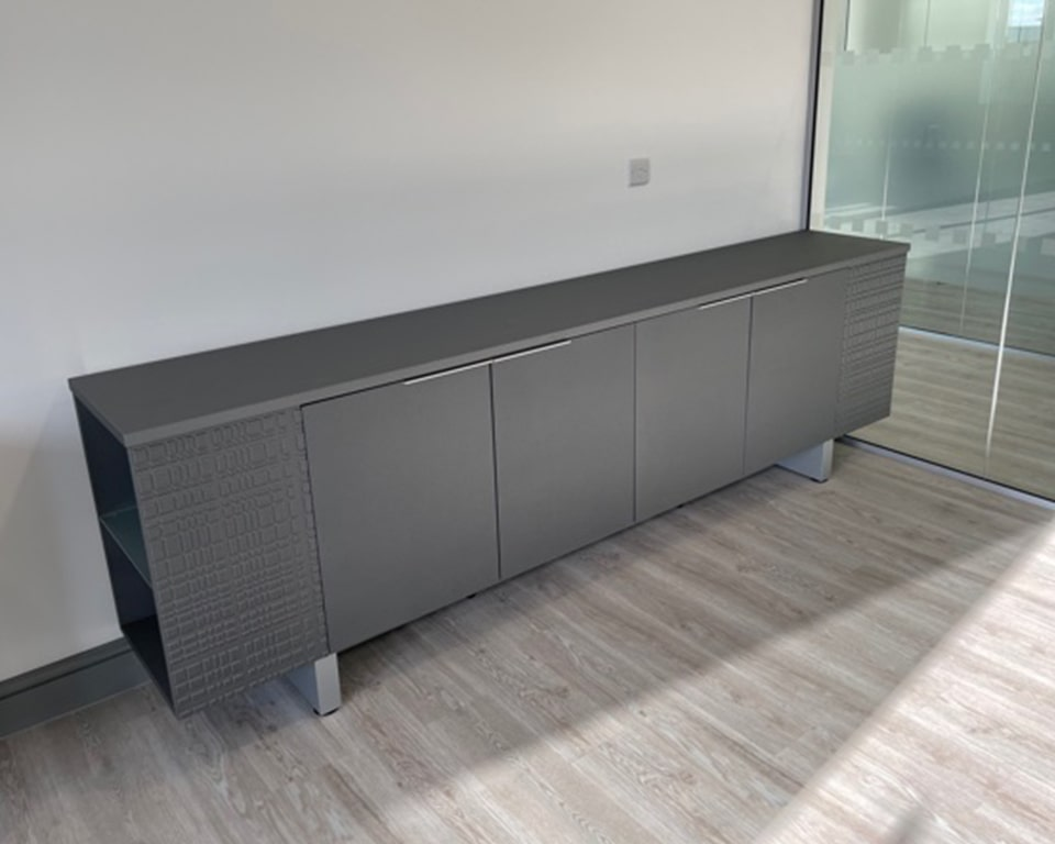 Long Modi sideboard in matt Asphalt grey lacquered with open bookcase ends and glass shelves