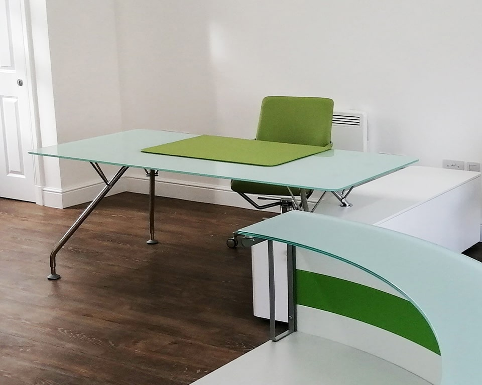 Prospero Glass desk with a Frosted Float glass desk top - matt white lacquered side return and chrome legs. Shown here with A lime green leather Tempo Chair and matching Lime green leather Scrivo desk pad