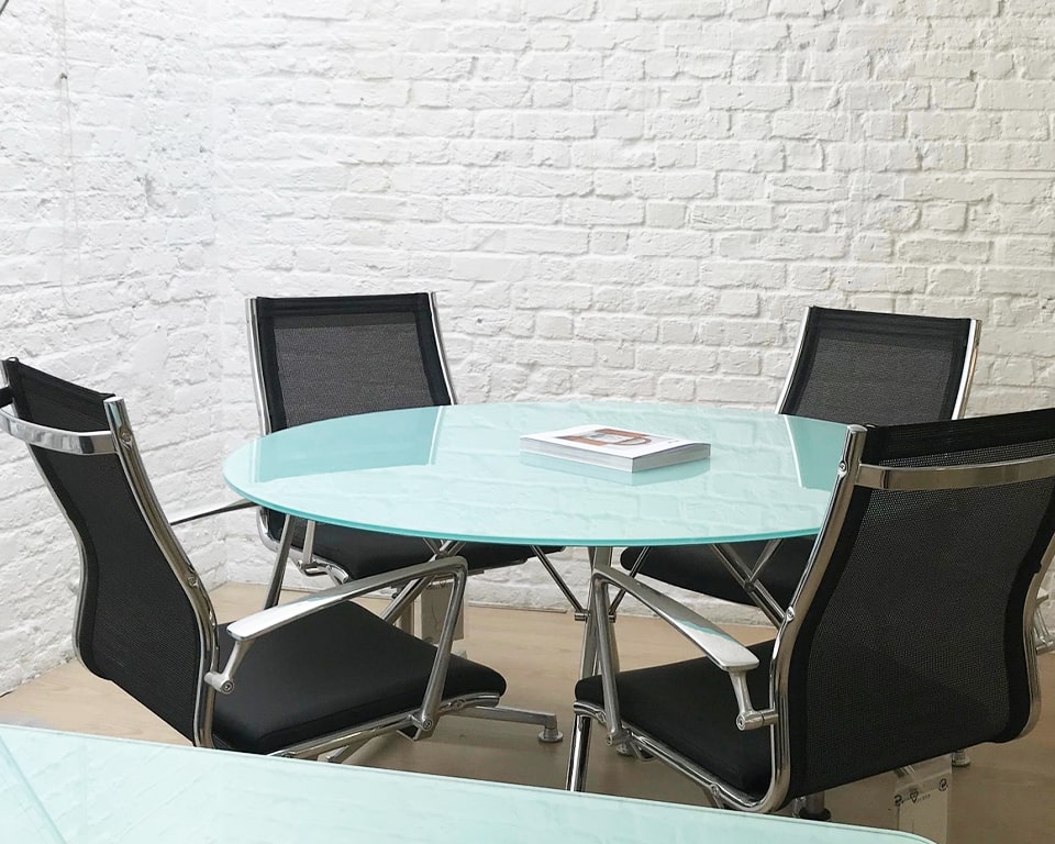 ROUND 1300 Diameter Frosted glass Meeting table with Chrome legs. Shown here with 4 Havana Mini boardroom chairs in black leather and black mesh